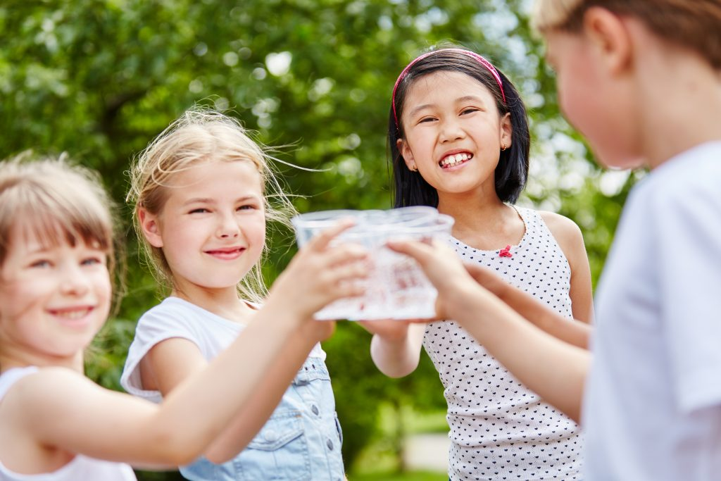 children enjoying healthy water from a water ionizer