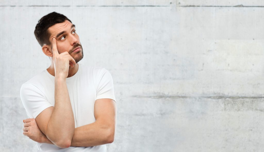 man thinking over gray background