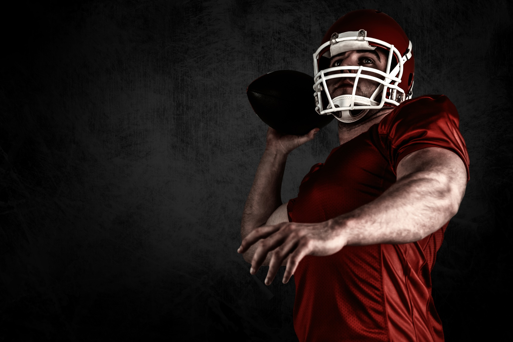 Composite image of american football player throwing ball