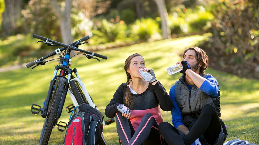 Feature | Couple bikers drinking water | Reasons to Love Tyent Water Ionizers, Part 6: Sports