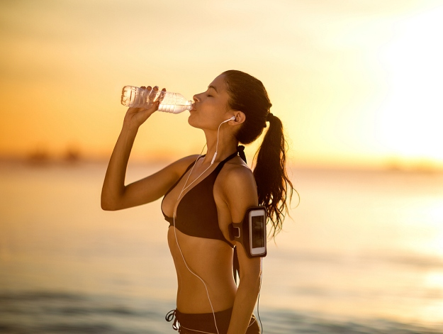 Beautiful woman jogging on a sunset | Reasons to Love Tyent Water Ionizers, Part 6: Sports