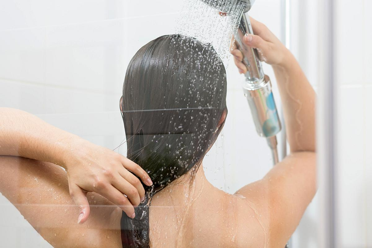 Girl washing hair under shower Reasons to Love Tyent Water Ionizers, Part 9: Tyent Alkaline Water Is The Healthiest Water In The World. Dare To Compare!