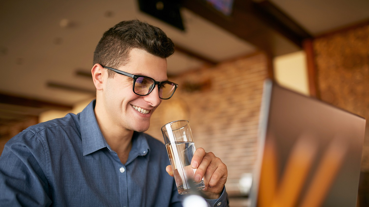 Feature | smiling man holding a glass of water | Reasons To Love Tyent Water Ionizers, Part 10: Tyent Alkaline Water Top Health Benefits At A Glance