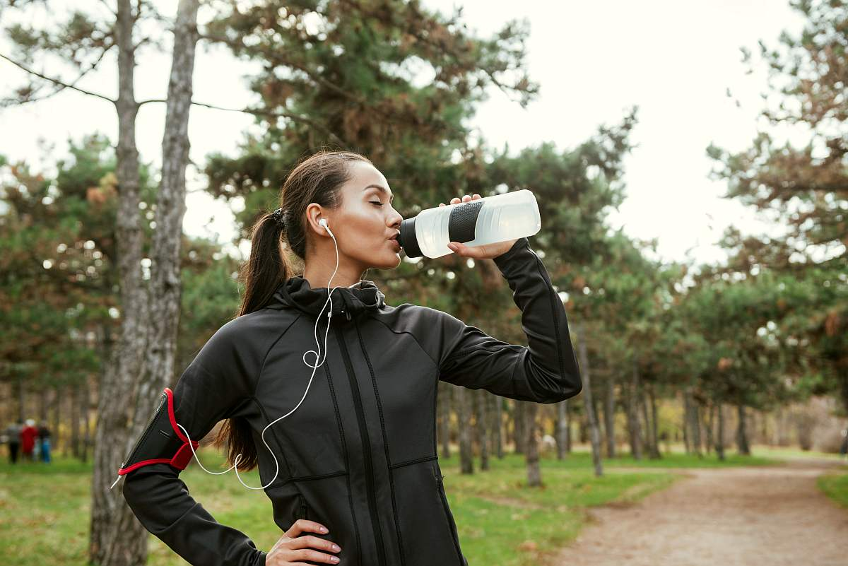 Young woman drinking water after running | Reasons To Love Tyent Water Ionizers, Part 10: Tyent Alkaline Water Top Health Benefits At A Glance