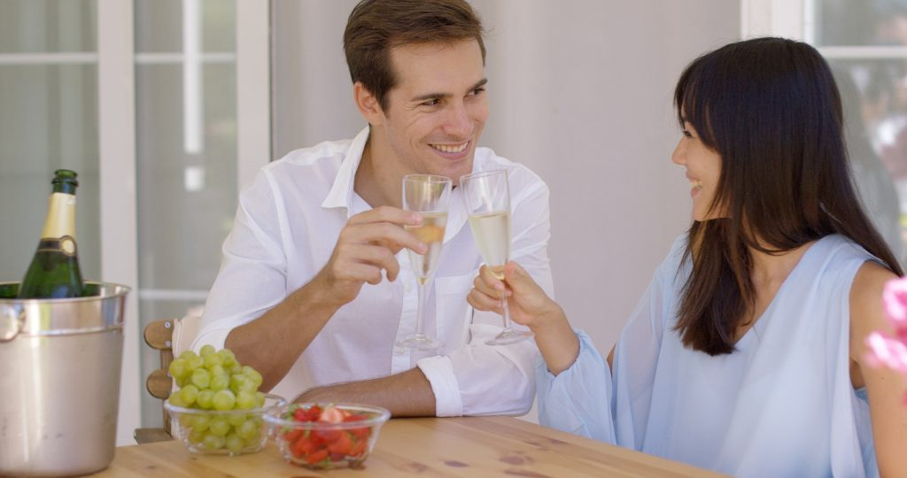 Cheerful couple toasting champagne