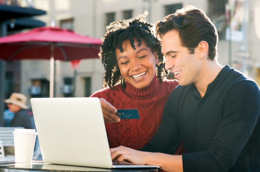 Couple shooping online with credit card