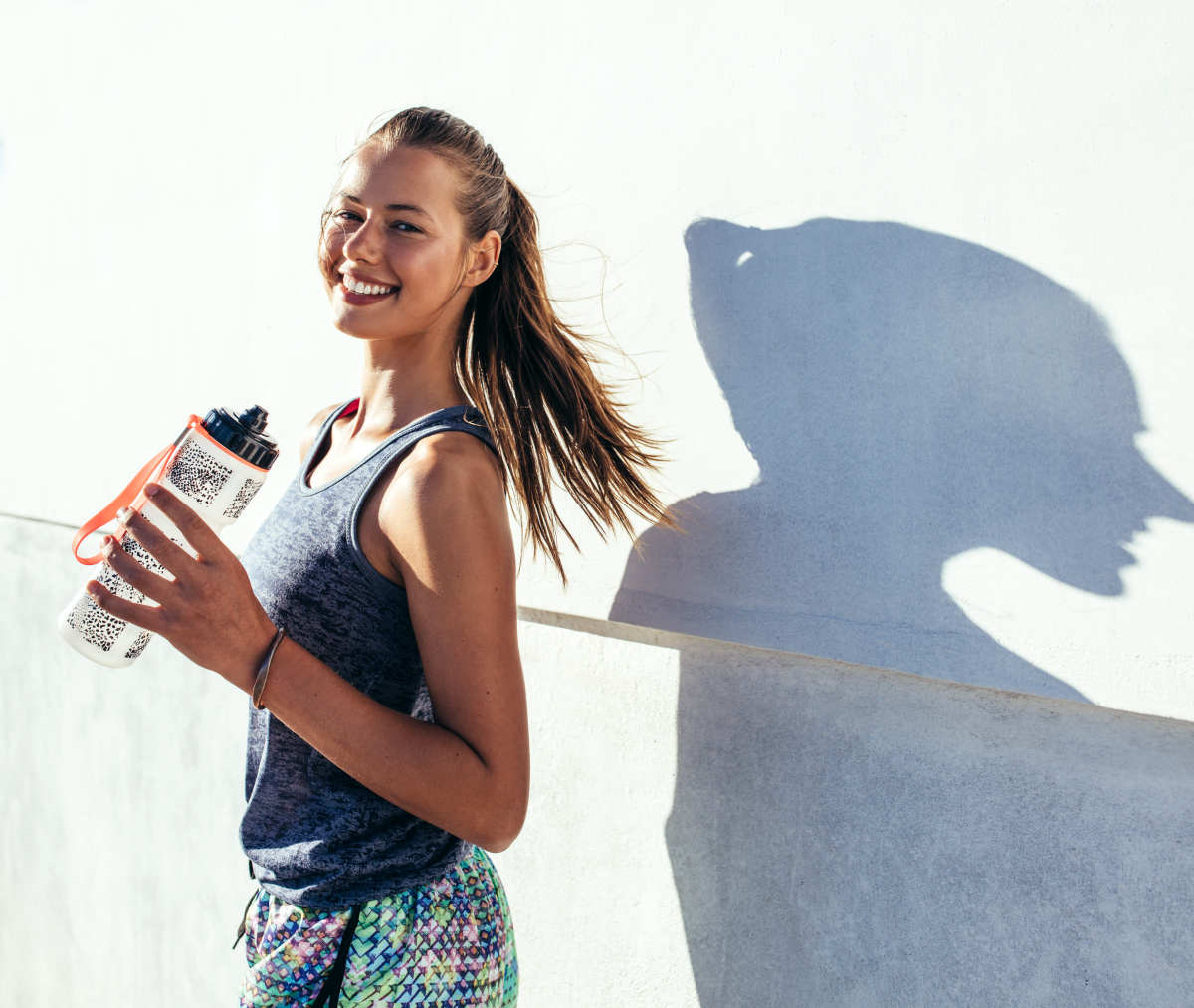 Beautiful female runner standing outdoors | Antioxidants and Its Benefits | Alkaline Water and Antioxidants