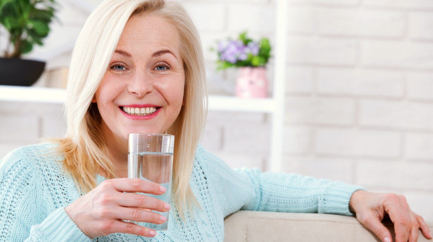 Feature | Beautiful middle aged woman drinking water | Slowing Down the Aging Process with Alkaline Water