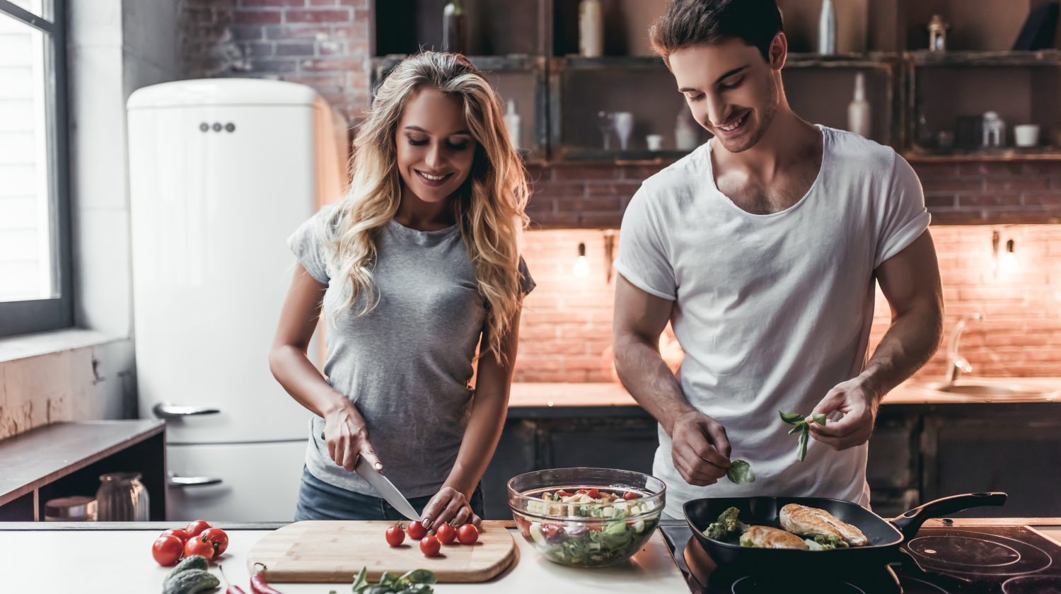 Feature | Attractive couple cooking on kitchen | Most Nutritious Foods to Add to Your Diet