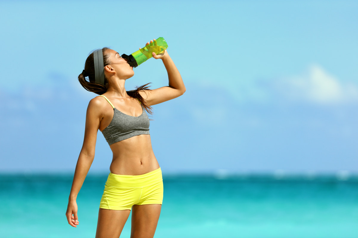 Fitness runner woman drinking water | Everything You Need To Know About Healthy Eating
