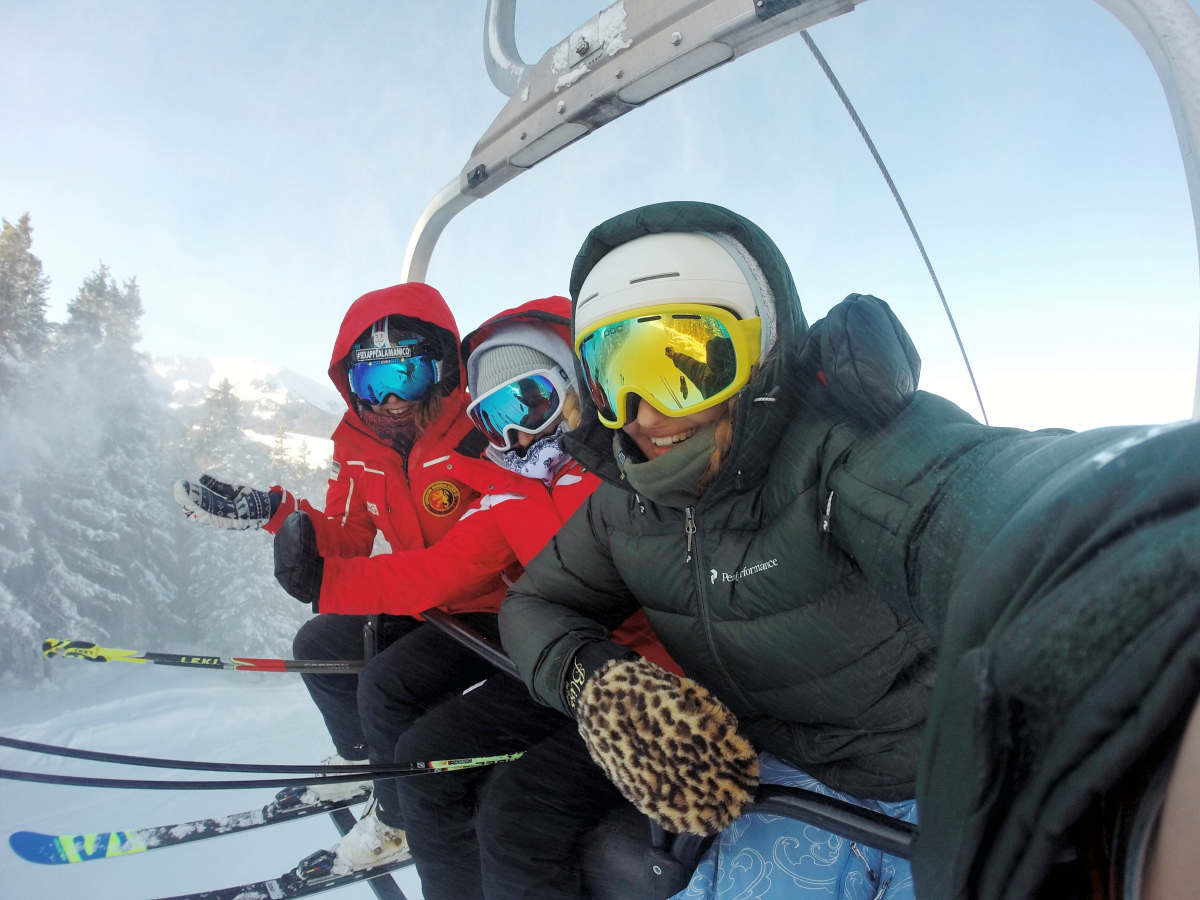 Three person wearing ski gear riding cable car | How to Maintain a Healthy Body