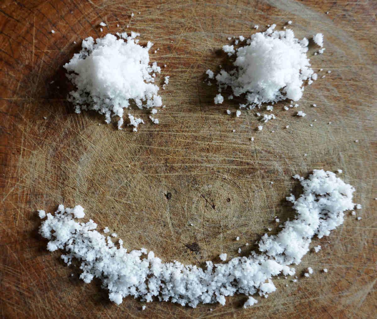 Smile salt on wood background | Epsom Salt Benefits | Epsom Salt: Health Benefits