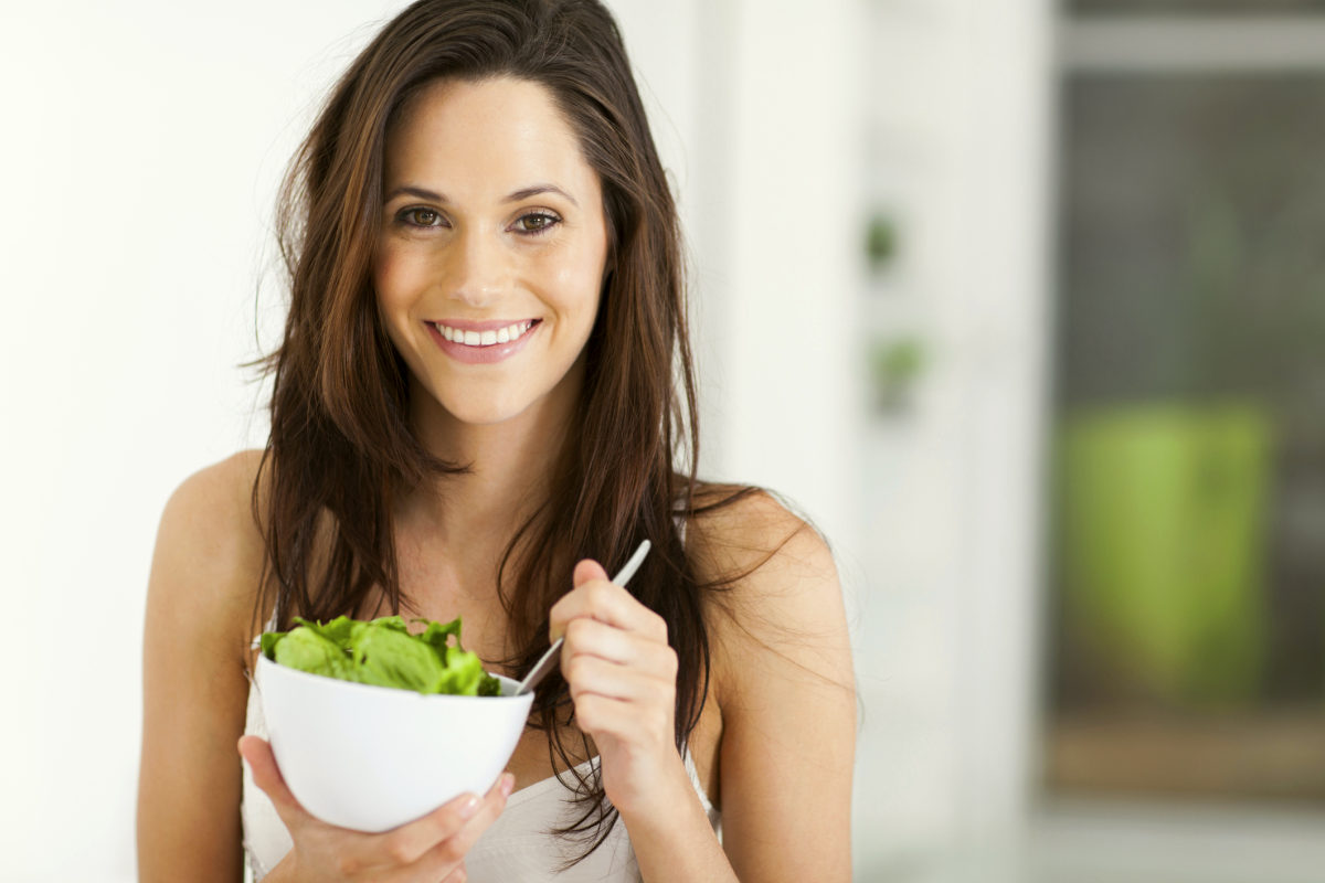 Woman eating healthy | Everything You Need To Know About Healthy Eating