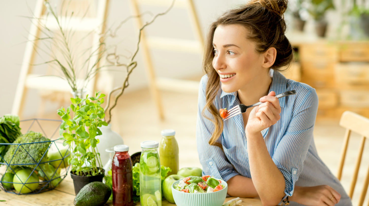 Feature | Young happy woman eating healthy salad | Everything You Need To Know About Healthy Eating