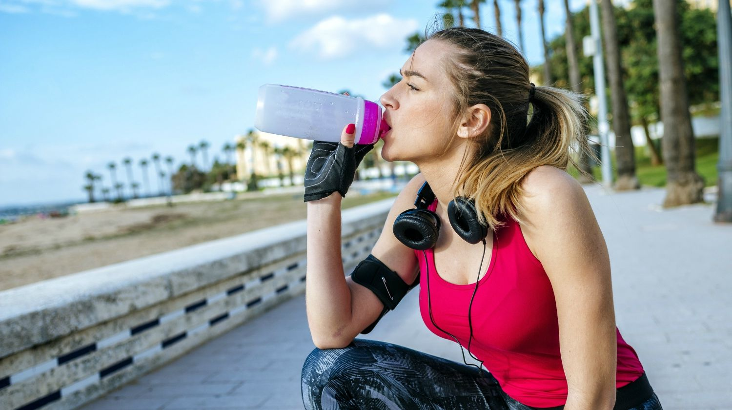 Young blonde sportswoman while drinking water after running | Why Alkaline Water Is Better For Hydration