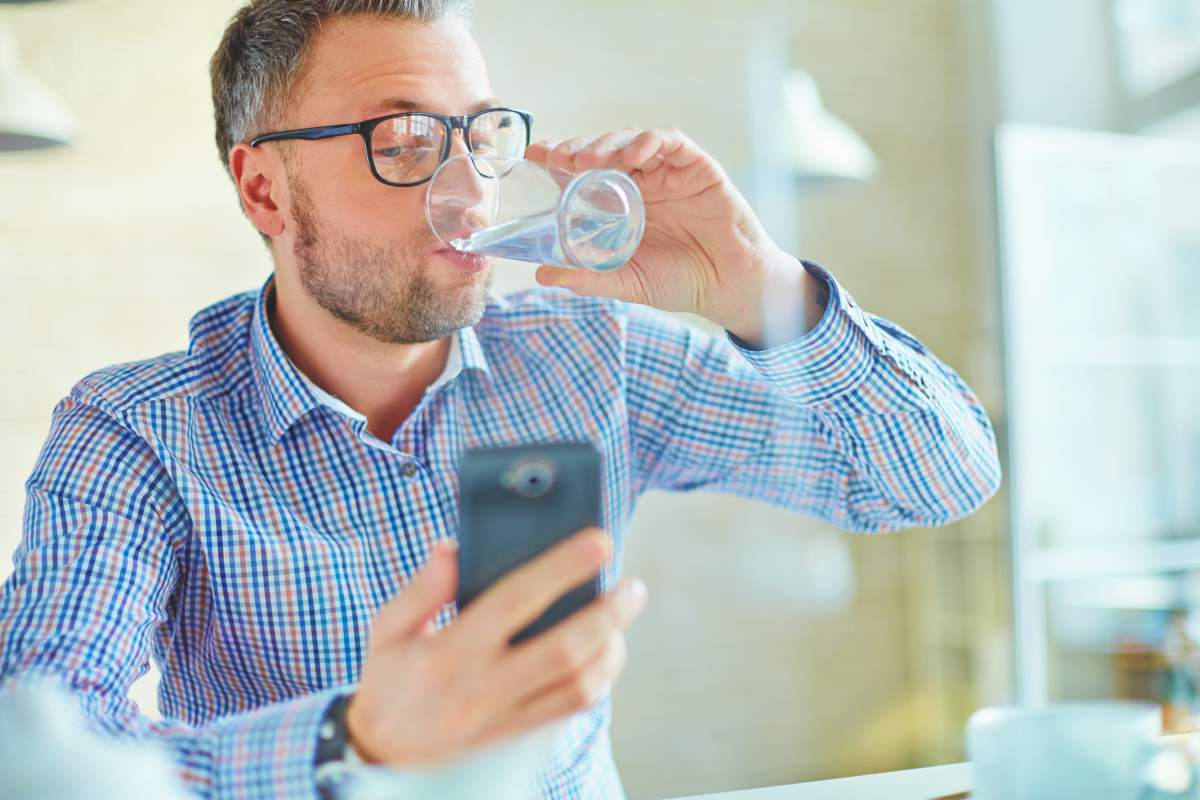 man drinking water | Ways To Restore Your Body's pH Balance | healthy ph balance