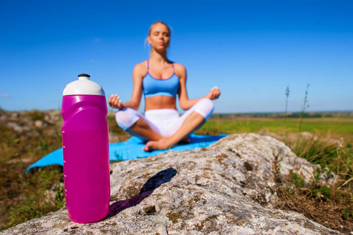 Sports and yoga girl drinking water | Ways To Drink More Water This Year