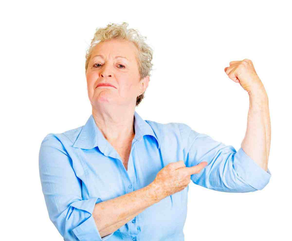 Woman showing her strength | Calcium Benefits: Alkaline Water is a Great Resource!