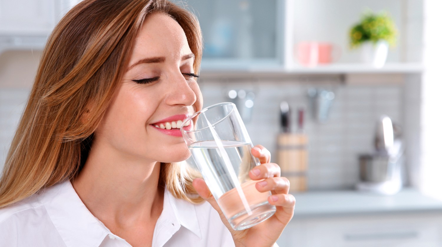 Feature |Young woman drining clean water glass | Benefits Of Drinking Water