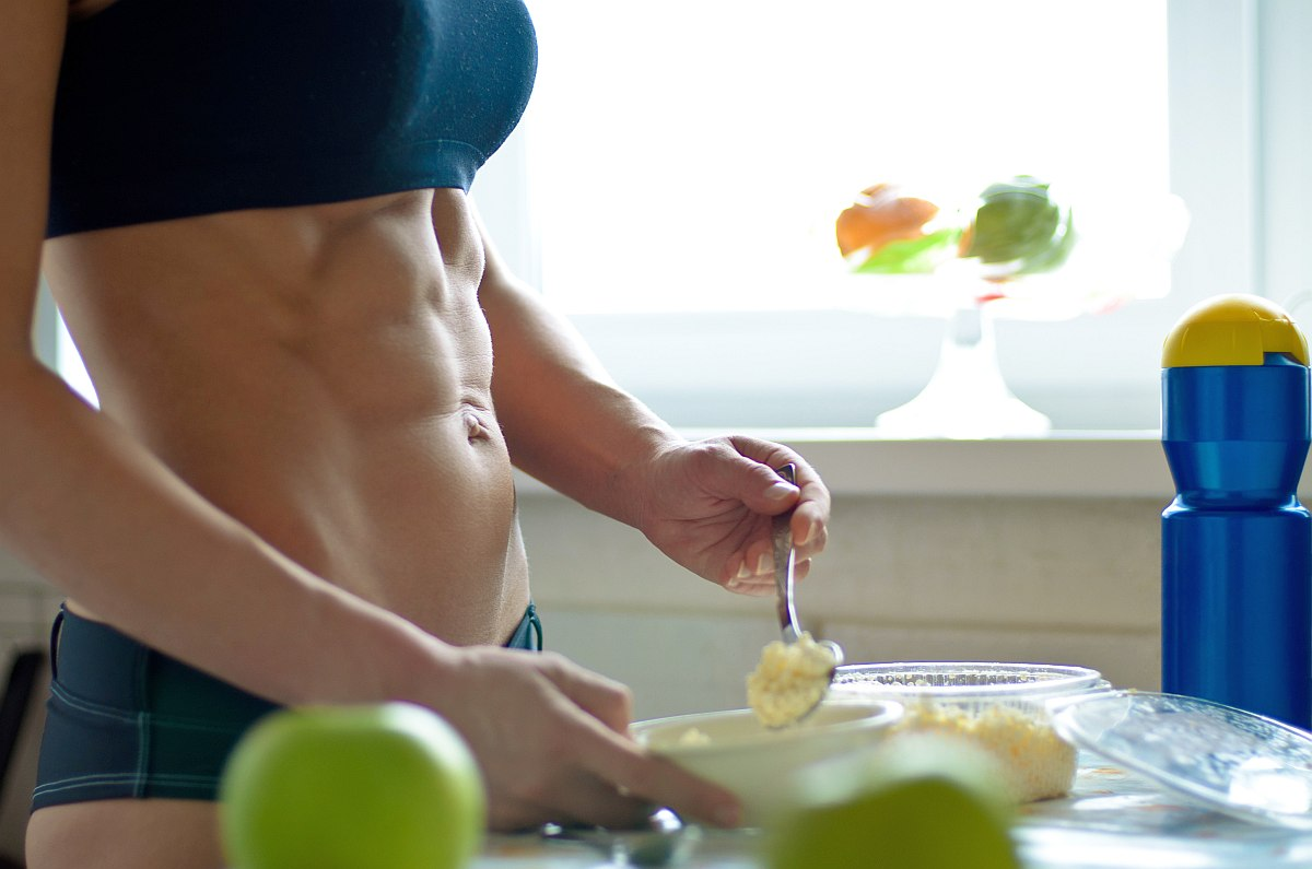 Young woman perfect abdominals cooks | Health Benefits of Probiotics