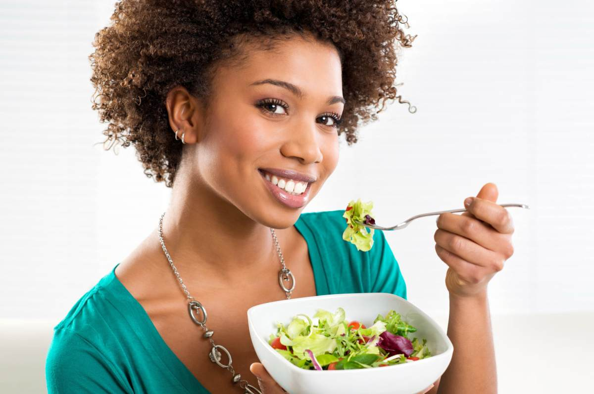 Beautiful African American Woman Eating Salad At Home | Health Tips And Hacks To Live By