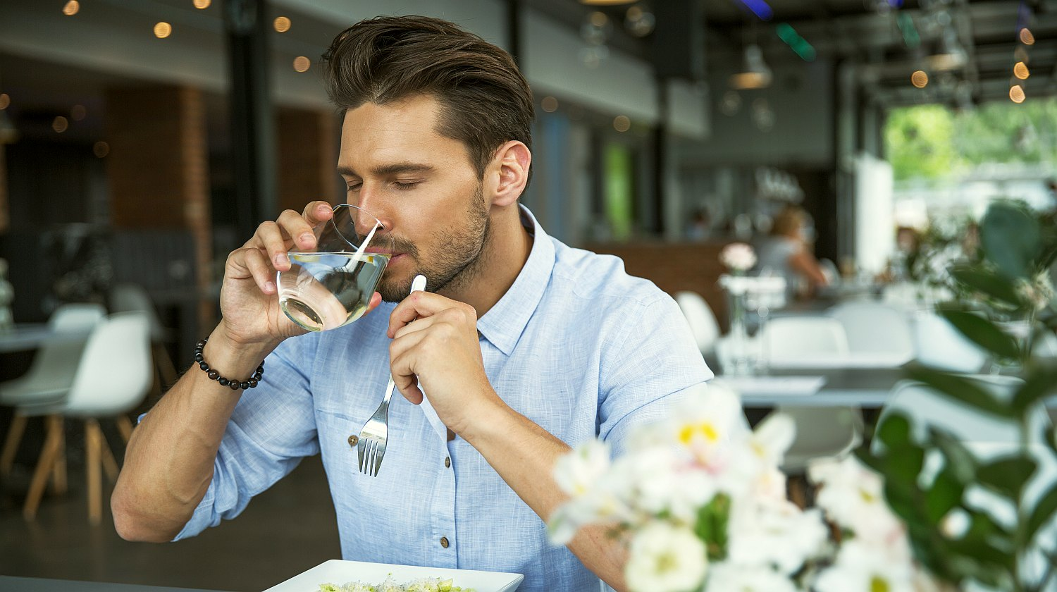 Feature | Handsome man drinking water | Health Tips And Hacks To Live By