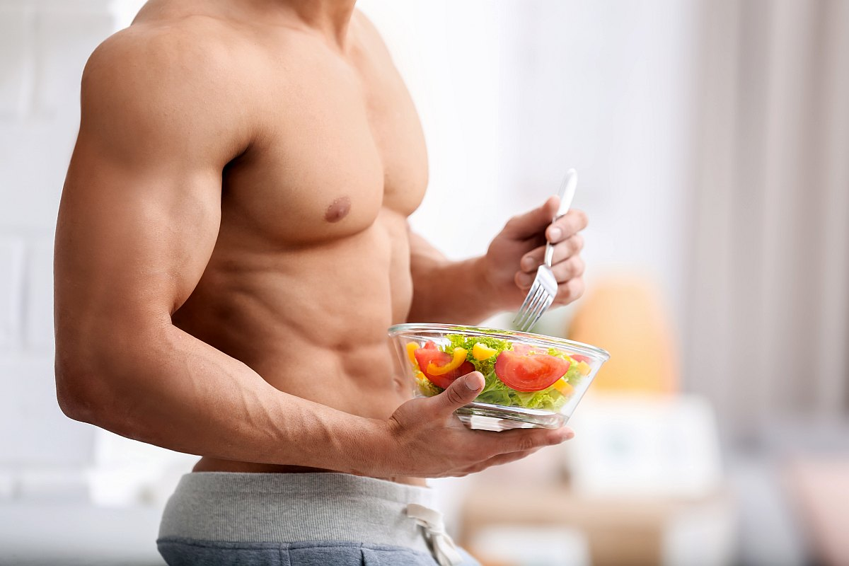 Man holding bowl of vegetable salad | What You Need To Know About The Alkaline Diet