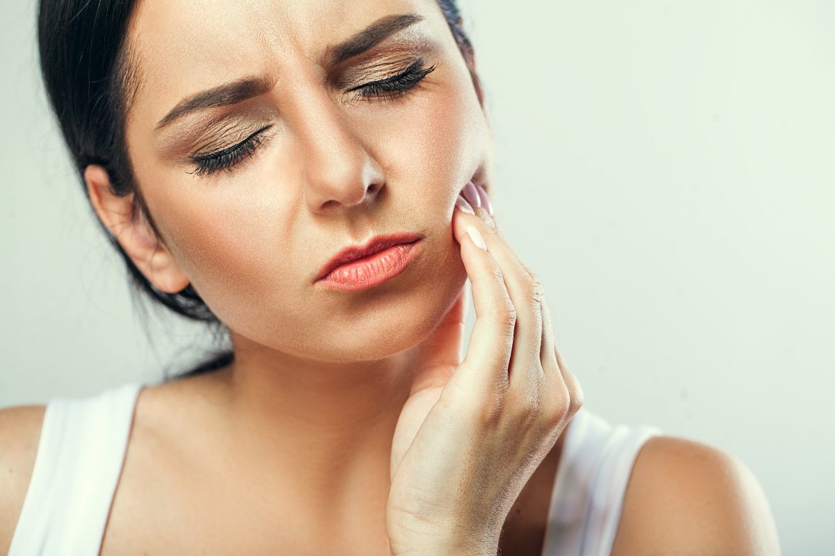 Woman suffering toothache | Reasons Why Acidic Water Is Bad For You