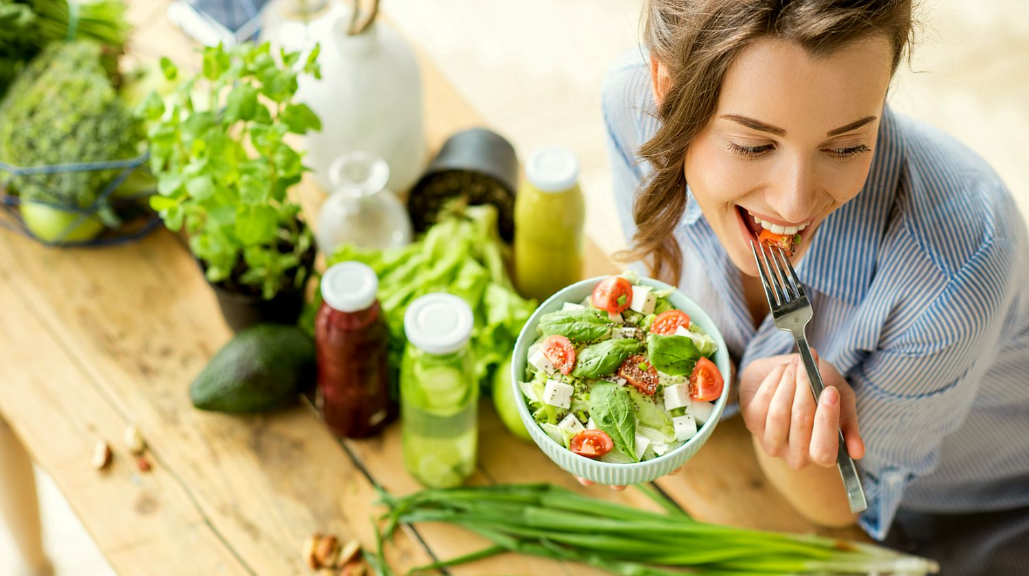 Feature | Beautiful woman eating salad | What You Need To Know About The Alkaline Diet
