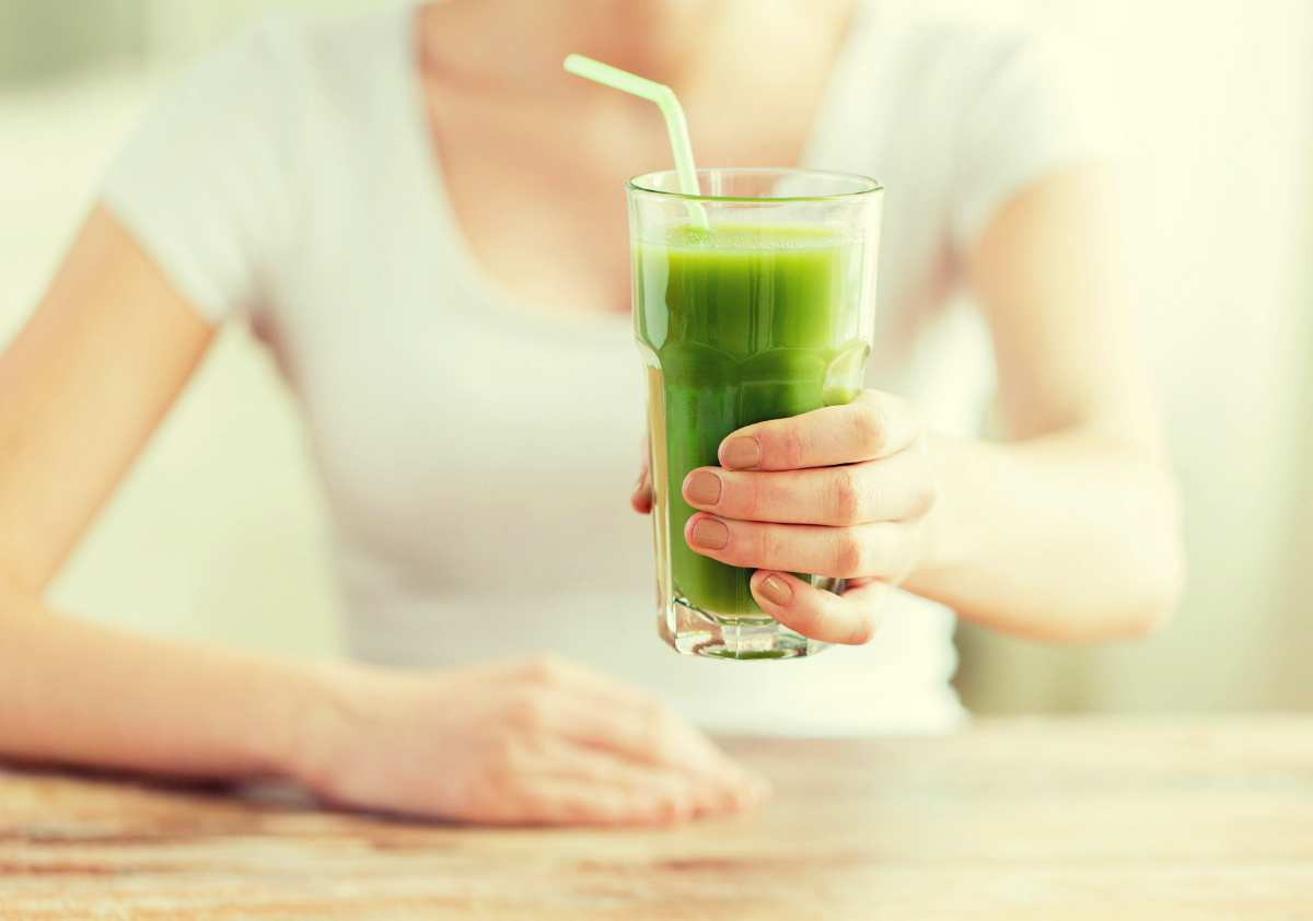Beautiful woman holding green juice | Healthy Juice Recipes You Should Try