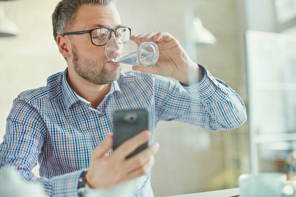 Man drinking water | What Exactly Is pH Level and Why Should I Care?