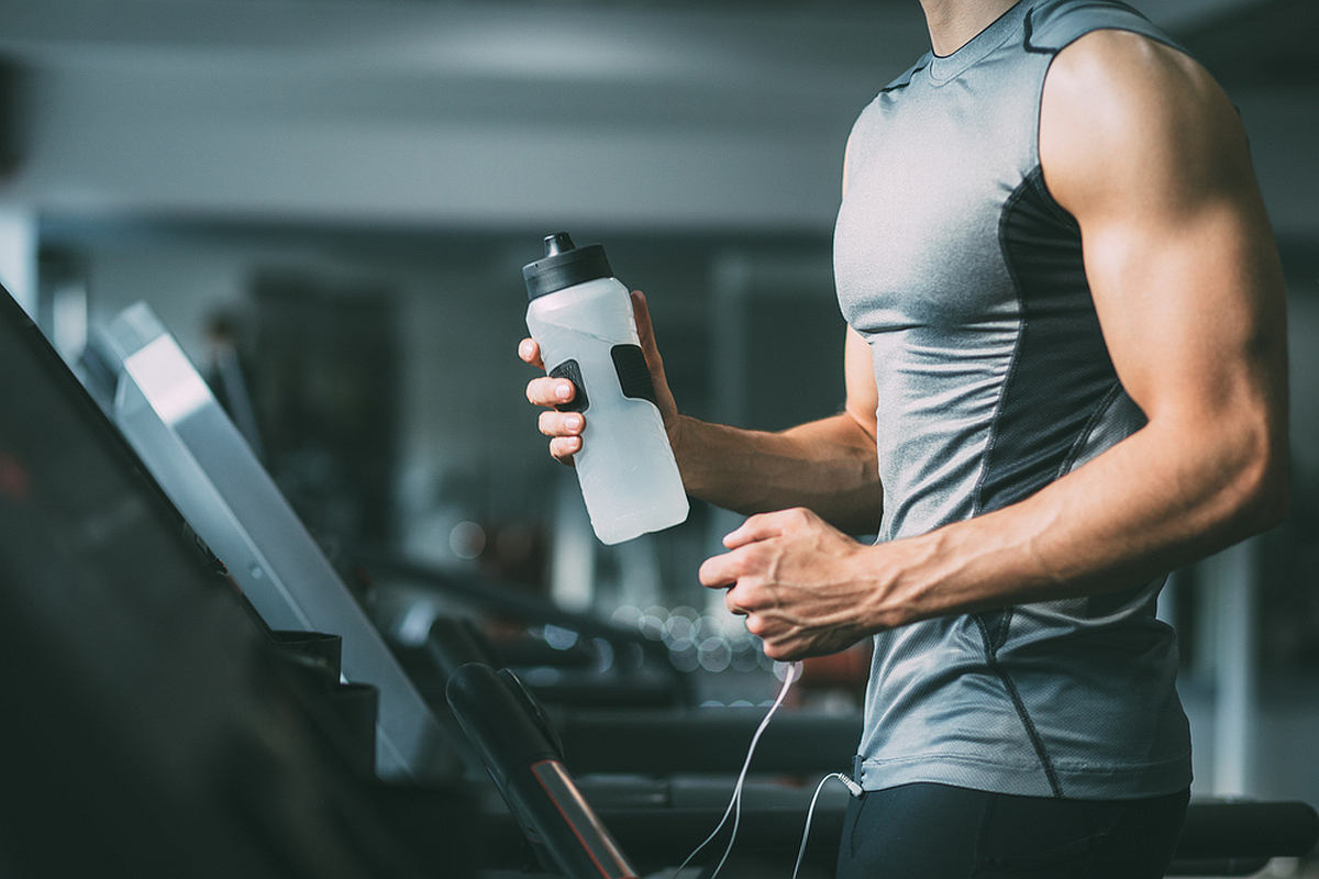 unrecognizable young man sportswear running on | Hacks to Stay Hydrated