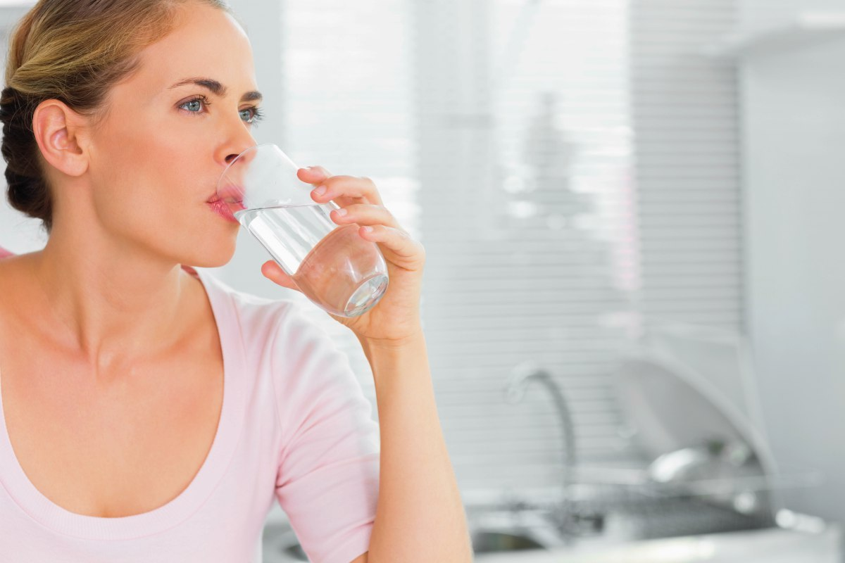 woman drinking water | Wastewater Treatment: Is It Safe To Drink Recycled Water? | wastewater treatment plant