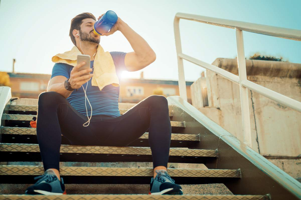 sporty man drinking water | Alkaline Water Benefits For Your Skin, Hair, And Health | alkaline water beauty benefits