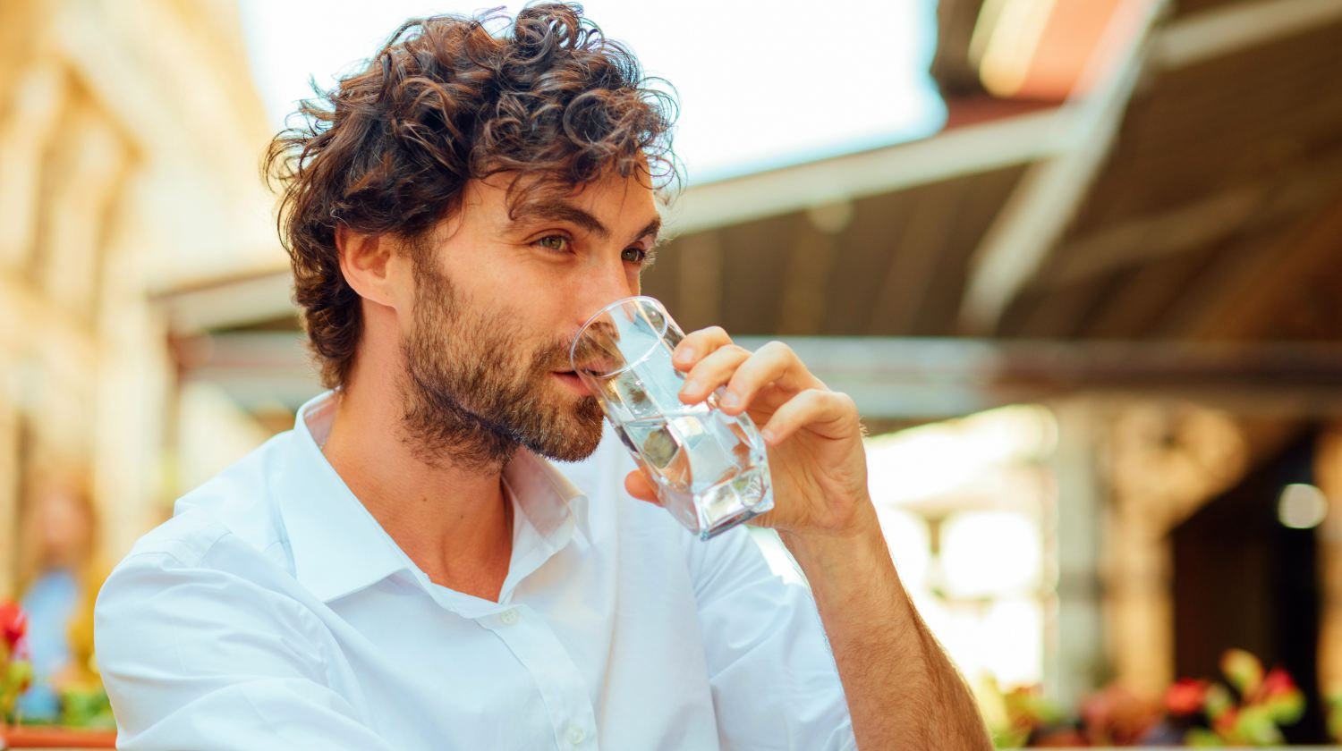 Feature   man drinking water   Why You Should Manage Your Fluid Intake To Treat Constipation   liquid intake