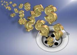 10684127-golden-dollar-symbols-going-down-a-sink-drain