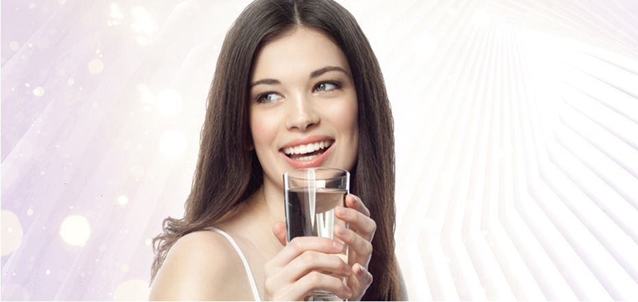Beautiful woman drinking Tyent water