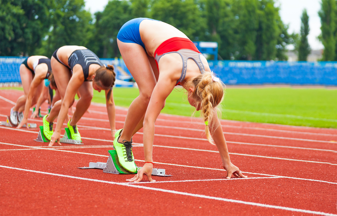 Female runners, getting on their marks