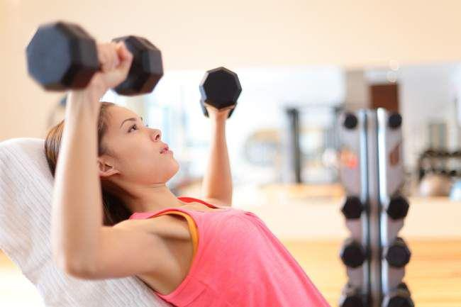 Woman lifting weights strength training